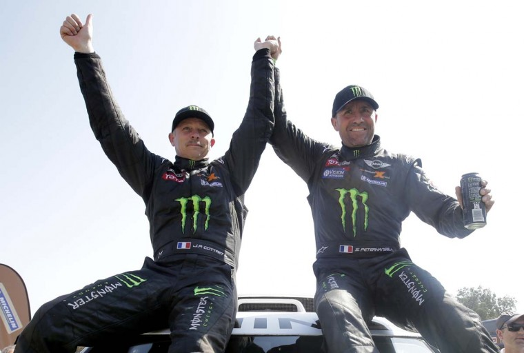 Mini pilot France's Stephane Peterhansel and co-pilot Jean-Paul Cottret celebrate after the 14th and last stage of the Dakar Rally 2013 from La Serena to Santiago, January 19, 2013. (Jacky Naegelen/Reuters)
