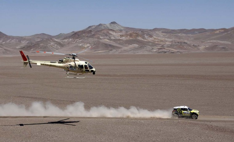 Spain's Nani Joan Roma and co-pilot France's Michel Perin compete with their Mini during the 13th stage of the Dakar Rally 2013 from Copiapo to La Serena, January 18, 2013. (Jacky Naegelen/Reuters)