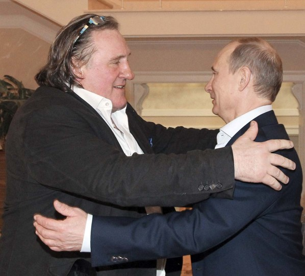 Russian President Vladimir Putin (R) greets French actor Gerard Depardieu during their meeting in Sochi January 5, 2013. Depardieu arrived in Russia on Saturday to meet Putin, who granted him citizenship after a public spat in France over his efforts to avoid a potential 75 percent income tax. Picture taken January 5, 2013. (Mikhail Klimentyev/RIA Novosti via Reuters)