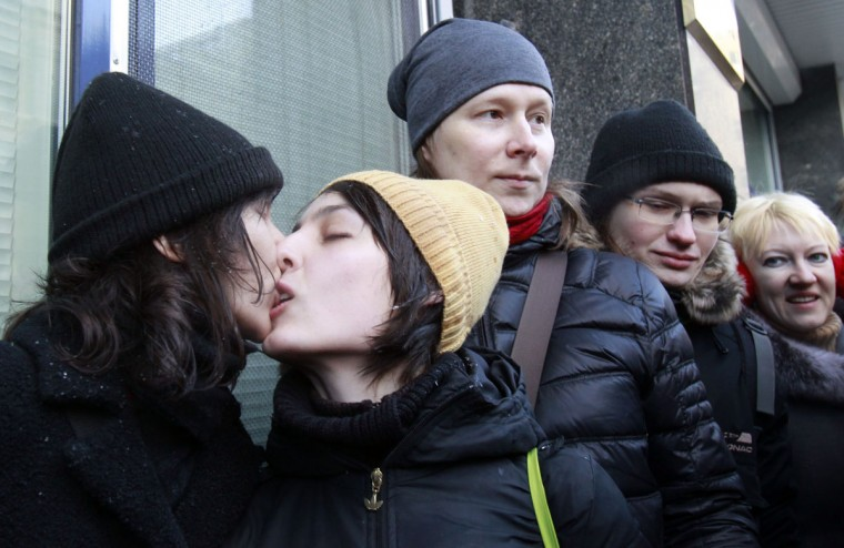 "Women share a kiss during a protest near the Duma, Russia's lower house of Parliament, in Moscow. Russia's parliament is due to hold its first reading on a ""homosexual propaganda"" law on Friday, which was earlier postponed. Russian lawmakers may adopt the bill that bans promotion of homosexual, lesbian, bisexual, and transgender practices among minors and imposes large administrative fines for spreading propaganda of this kind during concerts in particular, according to local media. (Sergei Karpukhin/Reuters)"