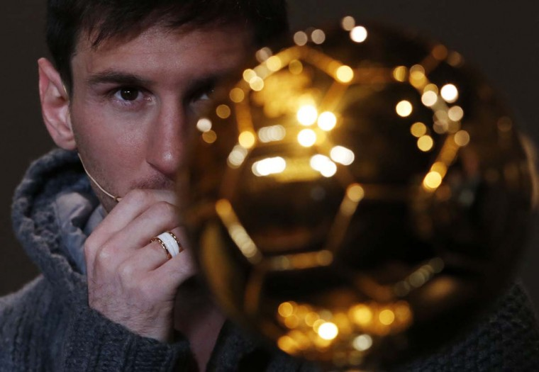 FIFA Men's Ballon D'Or of the Year 2012 nominee Lionel Messi of Argentina looks at the trophy during a news conference before the FIFA Ballon d'Or 2012 soccer awards ceremony at the Kongresshaus in Zurich January 7, 2013. (Michael Buholzer/Reuters)