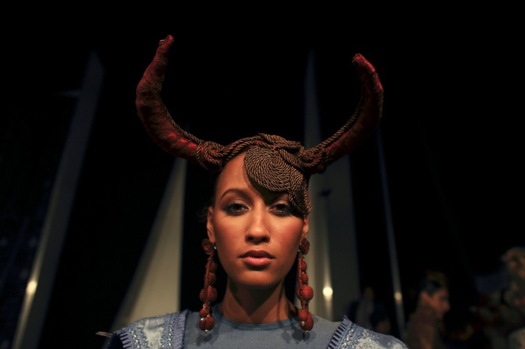 Spanish model Natalia Calixte, 19, wearing a creation by Virginia Herrera, poses backstage during the International Flamenco Fashion Show (SIMOF) in the Andalusian capital of Seville. (Marcelo del Pozo/Reuters)