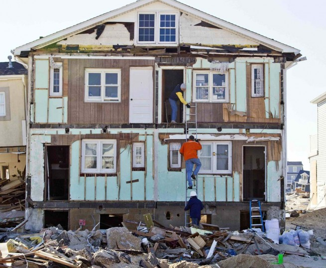 One man holds a ladder for another as he climbs to the second floor of a home that was heavily damaged by Hurricane Sandy, in Ortley Beach, New Jersey January 7, 2013. Continuous efforts are underway to rebuild parts of the town destroyed in late October 2012 by the superstorm. (Tom Mihalek/Reuters)