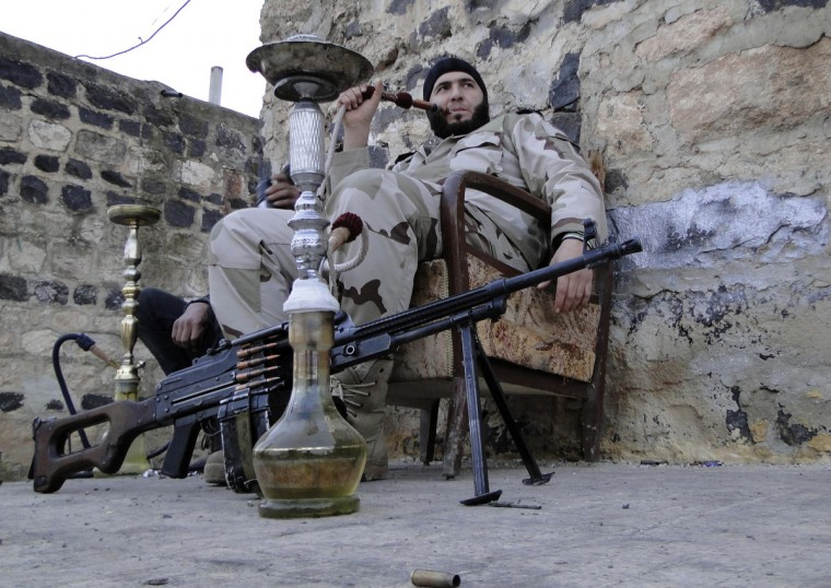 Free Syrian Army fighters smoke waterpipes near the Menagh military airport, in Aleppo's countryside January 25, 2013. (Mahmoud Hassano/Reuters)