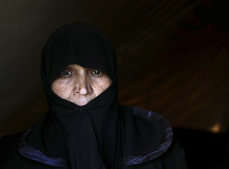 An internally displaced woman looks out of a tent in a village outside Damascus January 29, 2013. (Goran Tomasevic/Reuters)