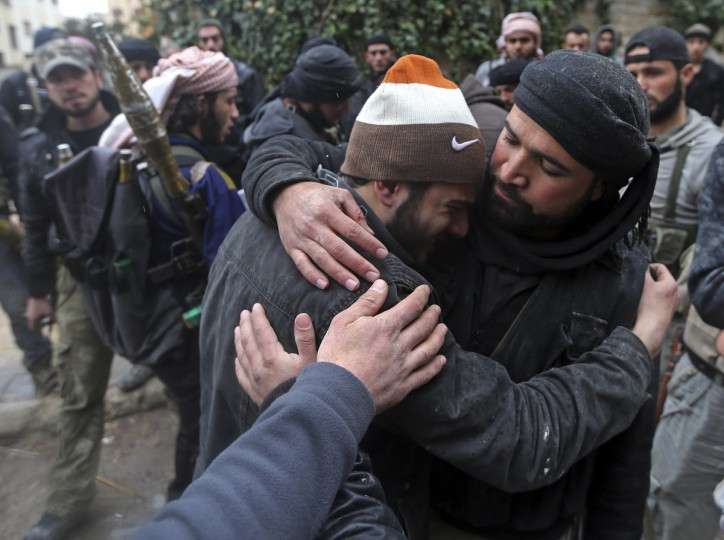 A wounded Free Syrian Army fighter cries after hearing that his friend died in a mission in the Ain Tarma neighborhood of Damascus January 30, 2013. (Goran Tomasevic/Reuters)