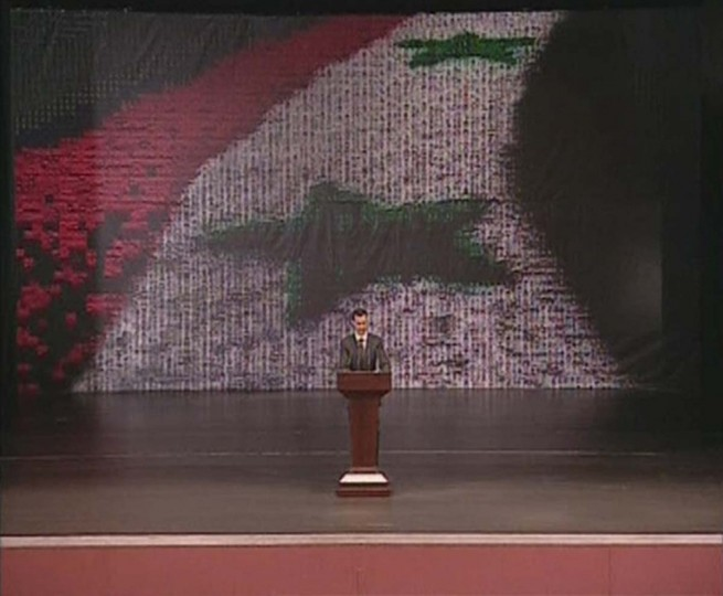 Syria's President Bashar al-Assad speaks at the Opera House in Damascus in this still image taken from video January 6, 2013. (Syrian TV via Reuters)