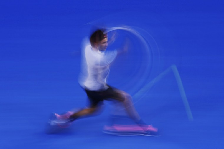 Roger Federer of Switzerland hits a return to Andy Murray of Britain during their men's singles semi-final match at the Australian Open tennis tournament in Melbourne. (David Gray/Reuters)