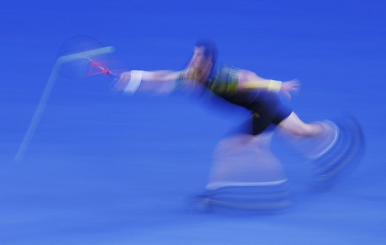 Andy Murray of Britain hits a return to Roger Federer of Switzerland during their men's singles semi-final match at the Australian Open tennis tournament in Melbourne. (David Gray/Reuters)