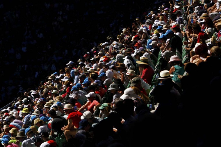 Fans watch the tennis action at Rod Laver Arena during the Australian Open tennis tournament in Melbourne January 22, 2013. (Navesh Chitrakar/Reuters)
