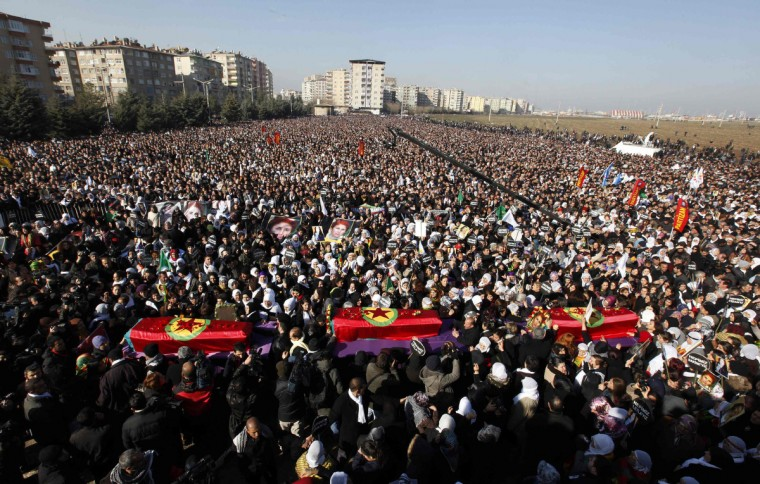Thousands attend the funeral ceremony of the three Kurdish activists shot in Paris, in Diyarbakir, the largest city in Turkey's mainly Kurdish southeast. The bodies of the activists, including that of Kurdistan Workers Party (PKK) co-founder Sakine Cansiz, arrived by plane on Wednesday evening in Diyarbakir. (Umit Bektas/Reuters photo)
