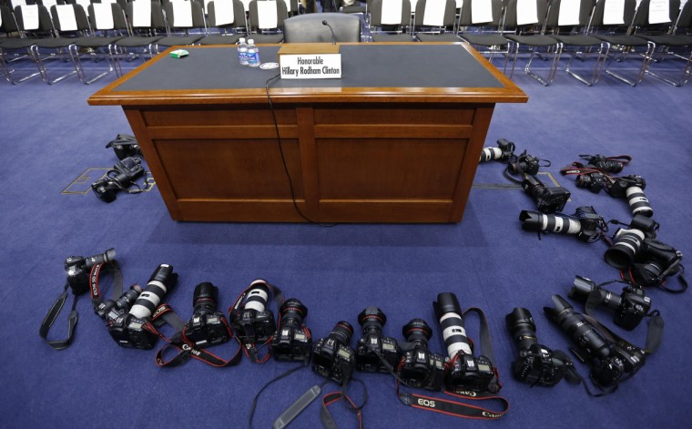 Cameras from news photographers surround a table before the arrival of U.S. Secretary of State Hillary Clinton to testify on the September attack on U.S. diplomatic sites in Benghazi, Libya, during a hearing held by the U.S. Senate Foreign Relations Committee on Capitol Hill in Washington. (Kevin Lamarque/Reuters)