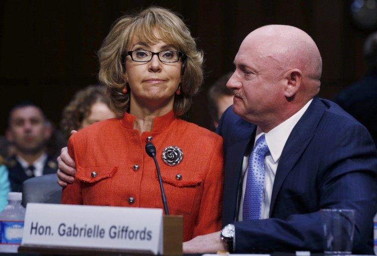 Former U.S. Rep. Gabrielle Giffords (L) delivers her opening remarks while seated next to her husband, former U.S. Navy Captain Mark Kelly, during a hearing held by the Senate Judiciary committee about guns and violence on Capitol Hill in Washington. (Larry Downing/Reuters)