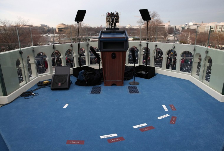 Placemarks are set for the Obama and Biden families on stage. (REUTERS)