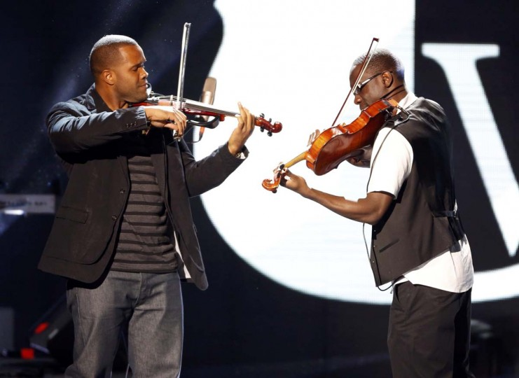 Black Violin perform at the Kids Inaugural concert for children and military families, one of the events ahead of the second-term inauguration of U.S. President Barack Obama in Washington January 19, 2013. (Jonathan Ernst/Reuters)