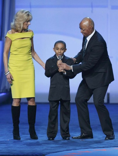 Jaelen Franco (C), son of a Navy corpsman speaks as Jill Biden (L), wife of U.S. Vice President Joe Biden and J.R. Martinez (R) watch at the Kids Inaugural concert for children and military families, one of the events ahead of the second-term inauguration of U.S. President Barack Obama in Washington January 19, 2013. (Jonathan Ernst/Reuters)