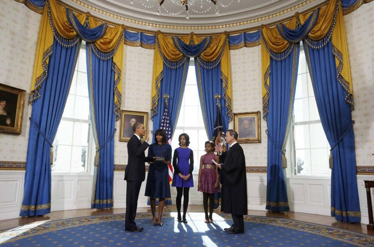 U.S President Barack Obama (L) takes the oath of office from U.S. Supreme Court Chief Justice John Roberts as first lady Michelle Obama holds the bible and their daughters Malia and Sasha (L-R) look on in the Blue Room of the White House in Washington, January 20, 2013. (Larry Downing/Reuters)