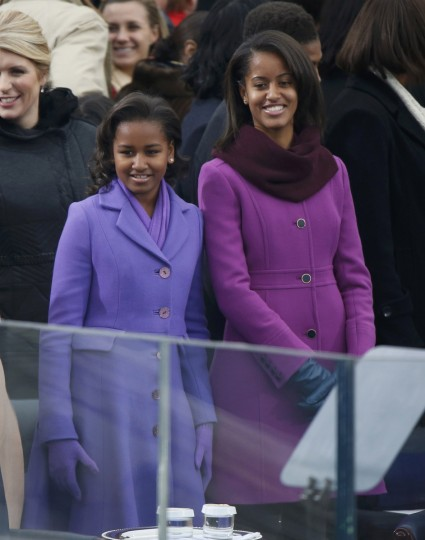 The daughters of President Barack Obama, Sasha and Malia, arrive for the swearing-in ceremonies for their father. (REUTERS/Jason Reed)