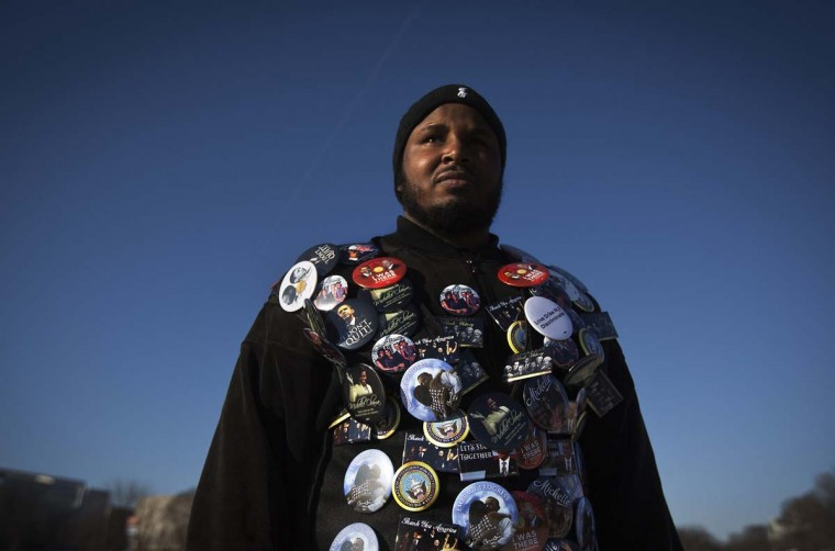 Tajidddin Ahmed of Atlanta, who is attending tomorrow's inauguration, wears a jacket filled with buttons in support of U.S. President Barack Obama as he stands on the National Mall in Washington January 20, 2013. (Shannon Stapleton/Reuters)