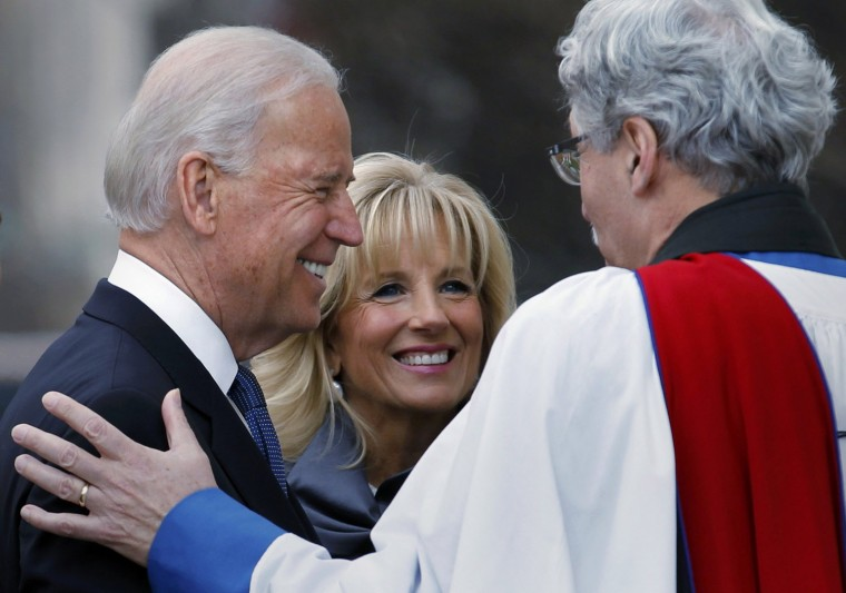 U.S. Vice President Joe Biden (L) and his wife, Dr. Jill Biden, talk with Reverend Luis Leon outside St. John's Church prior to inauguration ceremonies. (REUTERS)
