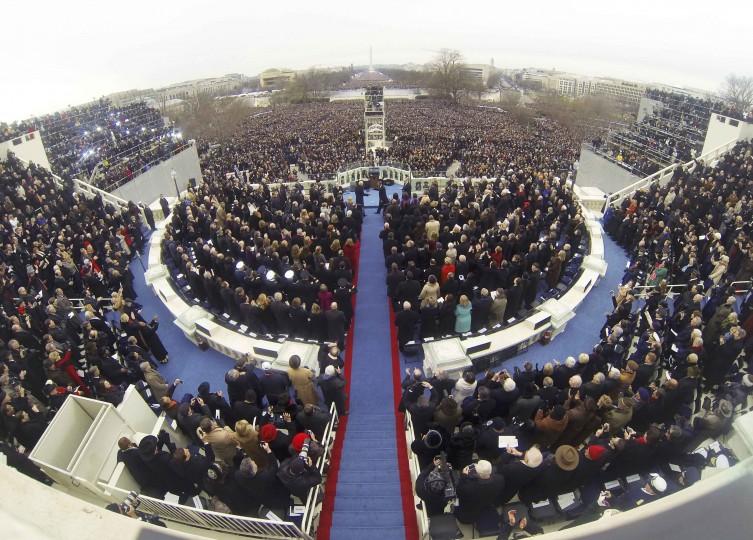 Vice President Joe Biden and President Barack Obama shake hands as thousands look on. (REUTERS/Rick Wilking)