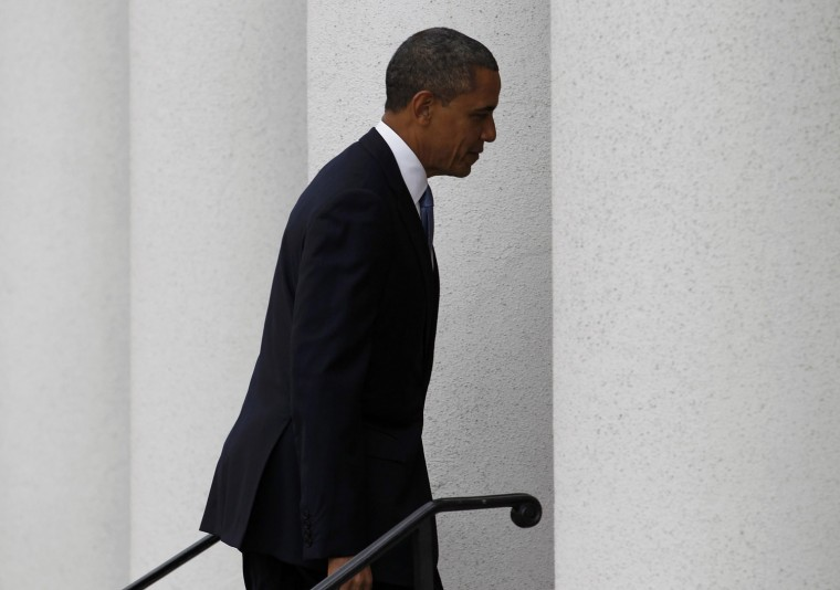 Obama arrives at St. John's Church for a service prior to inauguration ceremonies. (REUTERS/Joe Skipper)
