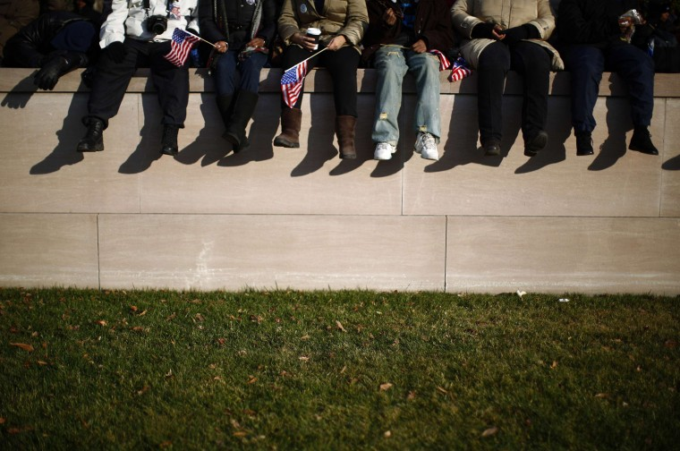People sit on a wall at the National Mall. (REUTERS/Eric Thayer)