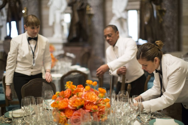 Catering staff prepare for the luncheon, which follows the inauguration ceremony. (REUTERS/Benjamin Myers)