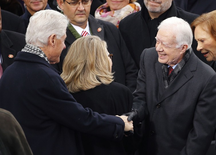 Former president Bill Clinton shakes hands with former president Jimmy Carter. (REUTERS/Brian Snyder)