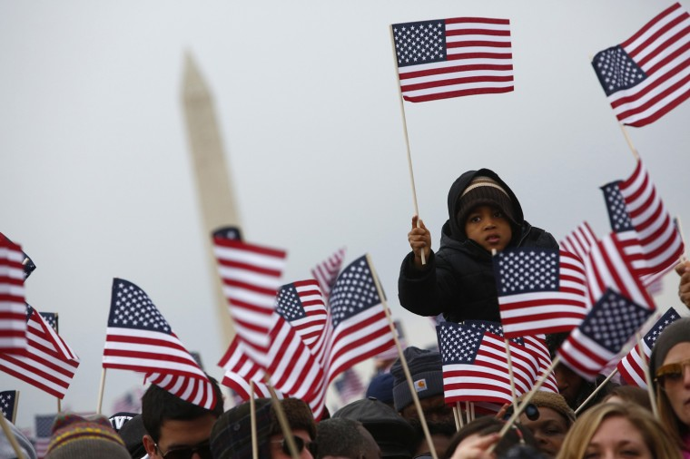 Spectators react on the National Mall during the 57th inauguration ceremonies. (REUTERS/Eric Thayer)