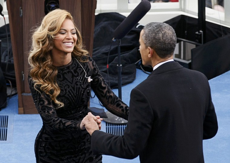 Beyonce is greeted by U.S. President Barack Obama after her performance during inauguration ceremonies. (REUTERS/Rick Wilking)