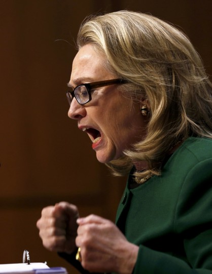 U.S. Secretary of State Hillary Clinton pounds her fists as she responds to intense questioning on the September attacks on U.S. diplomatic sites in Benghazi, Libya, during a Senate Foreign Relations Committee hearing on Capitol Hill in Washington. (Kevin Lamarque/Reuters)