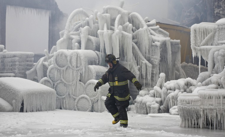 Chicago Fire Department Lieutenant Charley De Jesus walks around an ice-covered warehouse that caught fire Tuesday night in Chicago. Fire department officials said it is the biggest fire the department has had to battle in years and one-third of all Chicago firefighters were on the scene at one point or another trying to put out the flames. An Arctic blast continues to gripped the U.S. Midwest and Northeast Wednesday, with at least three deaths linked to the frigid weather, and fierce winds made some locations feel as cold as 50 degrees below zero Fahrenheit. (minus 46 degrees Celsius) (John Gress/Reuters)