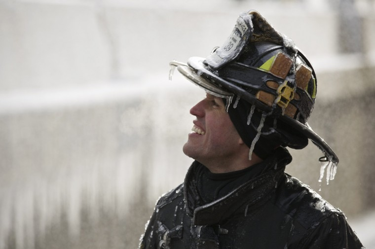 Firefighter Michael De Jesus is covered in ice as he mans a water cannon while fighting a warehouse fire in Chicago which caught fire Tuesday night. Fire department officials said it is the biggest fire the department has had to battle in years and one-third of all Chicago firefighters were on the scene at one point or another trying to put out the flames. (John Gress/Reuters)