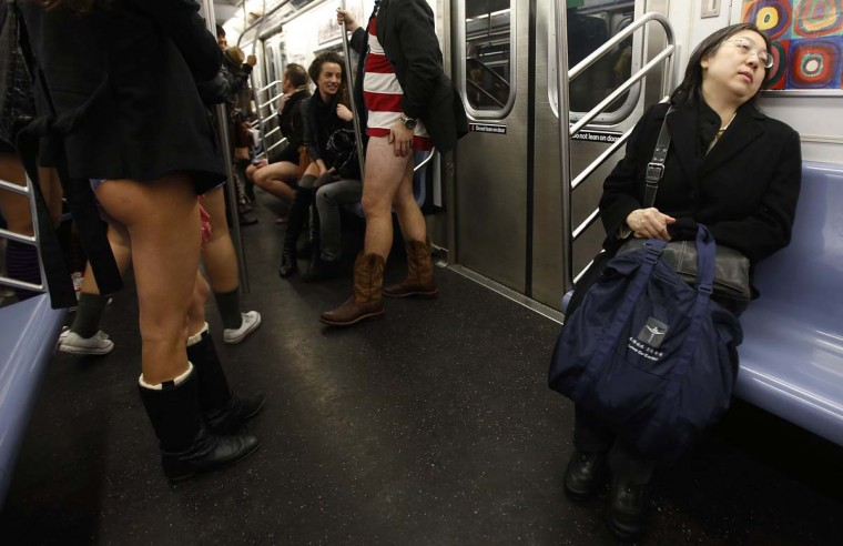 A woman reacts as people take part in the No Pants Subway Ride on the uptown 6 train in New York January 13, 2013. The event is an annual flash mob and occurs in different cities around the world, according to its organizers. (Carlo Allegri/Reuters)