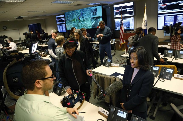 Reporters interview officials, including FBI Acting Assistant Director in Charge Debra Evans Smith (R) at the Multi-Agency Communications Center (MACC) in an undisclosed location in the Maryland suburbs near Washington, January 15, 2013. The MACC is a central location where security, defense and public safety agencies will coordinate efforts in case of problems during President Barack Obama's inauguration next week in Washington. (Jonathan Ernst /Reuters)