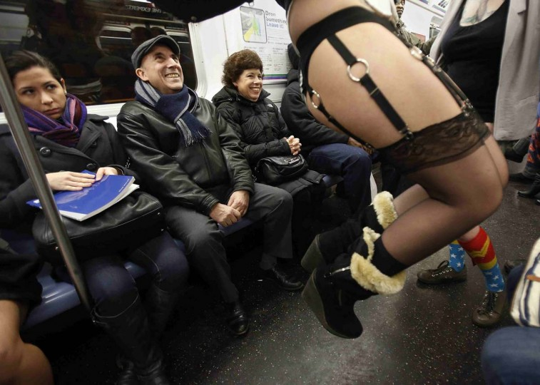 People watch as participants in the No Pants Subway Ride take the 6 train downtown in New York January 13, 2013. The event is an annual flash mob and occurs in different cities around the world, according to its organizers. (Carlo Allegri/Reuters)