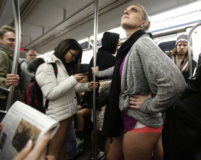 People take part in the No Pants Subway Ride on the uptown 6 train in New York January 13, 2013. The event is an annual flash mob and occurs in different cities around the world, according to its organizers.(Carlo Allegri/Reuters)