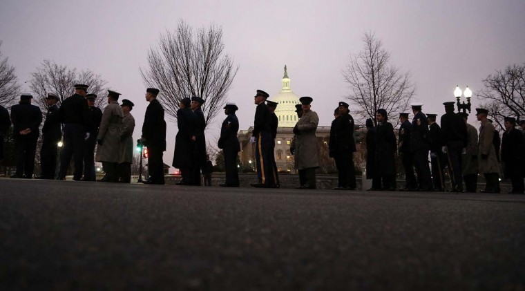 Members of the U.S. armed services arrive at the U.S. Capitol to line the parade route during a rehearsal for next week's inauguration ceremonies to mark the start of President Barack Obama's second term in Washington, January 13, 2013. (Jonathan Ernst/Reuters)