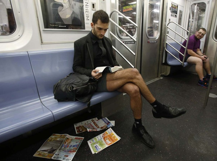 A participant in the No Pants Subway Ride takes the 6 train uptown in New York January 13, 2013. The event is an annual flash mob and occurs in different cities around the world, according to its organizers. (Carlo Allegri/Reuters)