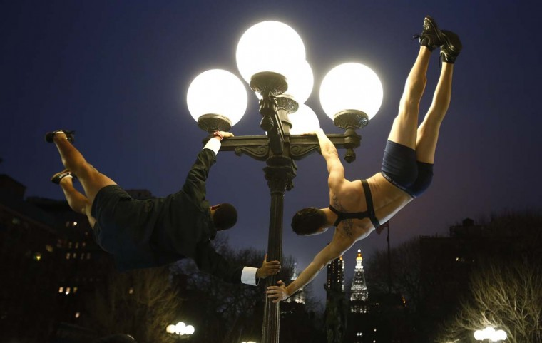 Men swing on a pole in Union Square park after the No Pants Subway Ride in New York January 13, 2013. The event is an annual flash mob and occurs in different cities around the world, according to its organizers. (Carlo Allegri/Reuters)