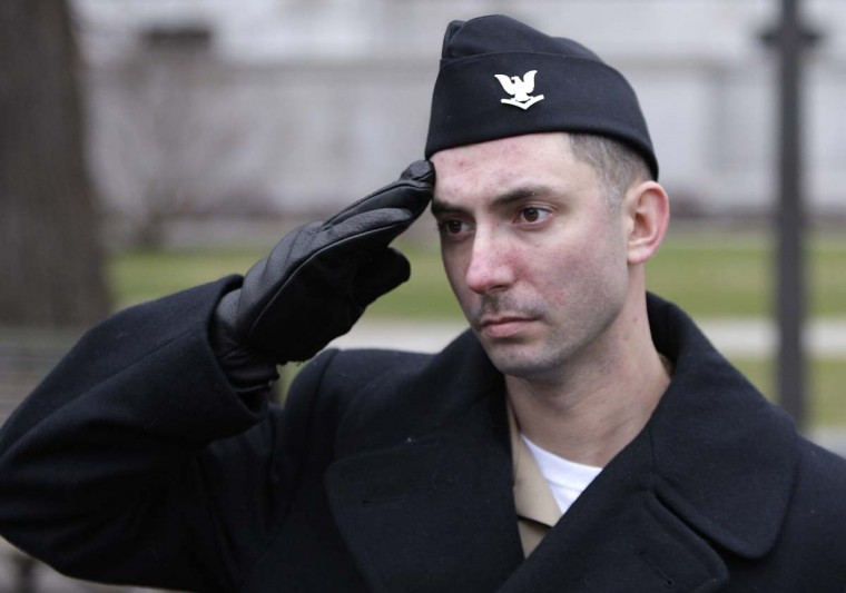 A member of the U.S. Navy salutes during a parade rehearsal for next week's inauguration ceremonies to mark the start of President Barack Obama's second term in Washington, January 13, 2013. (Jonathan Ernst/Reuters)