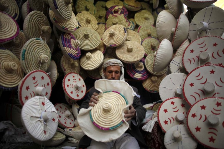 A vendor finishes a makhbaza, a traditional tool used for putting bread dough into ovens, at his shop in the Old Sanaa city January 6, 2013. (Khaled Abdullah/Reuters)
