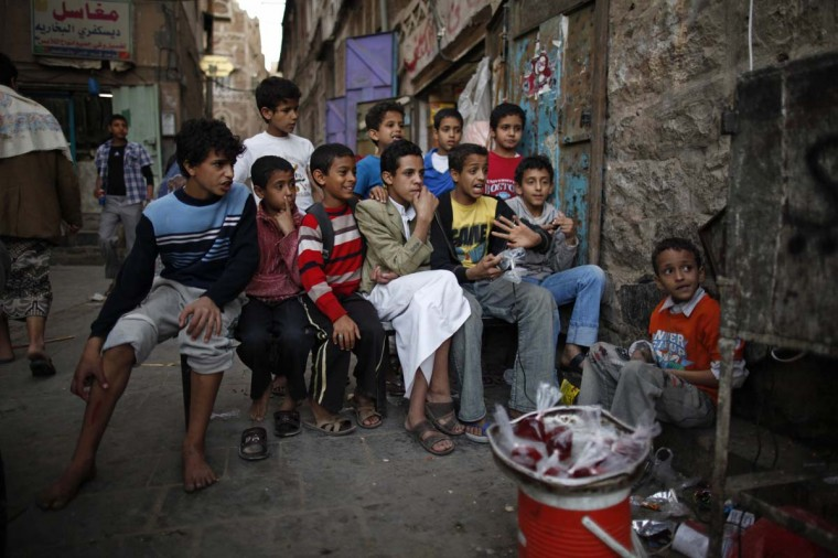 Boys watch television on a street in Old Sanaa city January 7, 2013. (Khaled Abdullah/Reuters)
