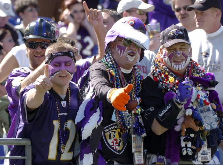 "Fan Man, center, cheers on the Ravens while they take on the Pittsburgh Steelers on Sept. 19, 2004. Flanking him on the left is Matt Lane and on the right is Dale ""Maniac"" Davis. (Kenneth L. Lam/Baltimore Sun Staff)"