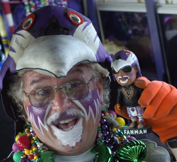The Fan Man has his own bobble head figure, which he occasionally will autograph and give out to his own fans. (Algerina Perna/Baltimore Sun Staff)