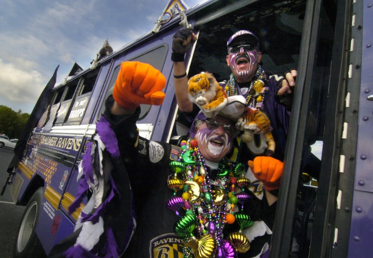 The Fan Man and Poetic Justice, one of his sidekicks, strike a pose in front of the Ravens fan bus in Sept. 2007. (Algerina Perna/Baltimore Sun Staff)