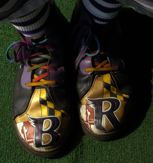 """Matt """"Fan Man"""" Andrews has a special pair of shoes to go with his Ravens costume."""
