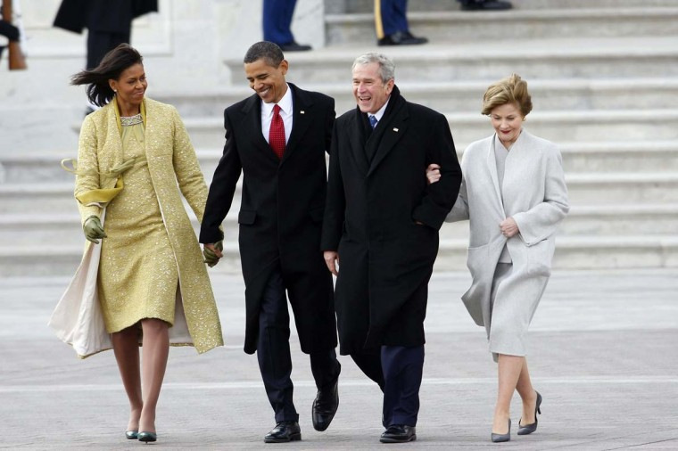 January 20, 2009 — President Obama holds the hand of first lady Michelle Obama, left, as they walk former President George W. Bush and wife, Laura, to their awaiting helicopter following Obama's inauguration Tuesday. (Brian Vander Brug/LA Times)