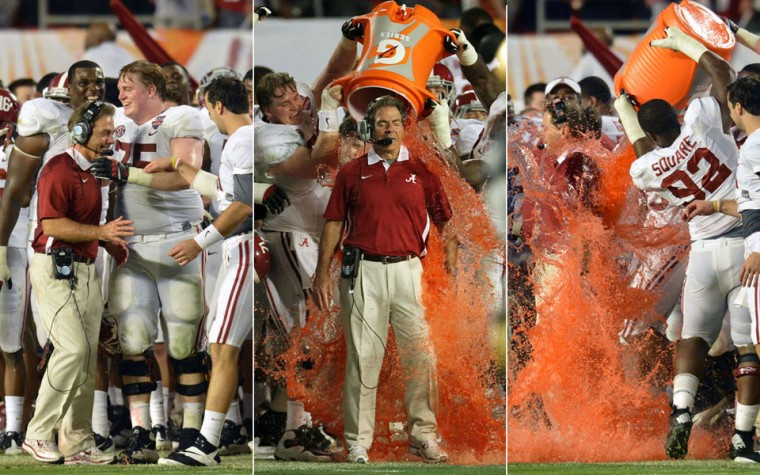 In this combination photo, Alabama head coach Nick Saban absorbs a ceremonial dunk following a 42-14 win against Notre Dame in the BCS National Championship game at Sun Life Stadium on Monday, January 7, 2013, in Miami Gardens, Florida. (Steve Mitchell/USA TODAY Sports; Al Diaz/Miami Herald/MCT)